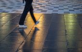 Постер, плакат: Young Man Walking On Wet Pavement