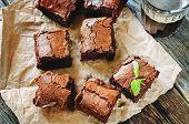 pic of brownie  - brownie on a dark wood background - JPG