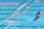 A Water Polo Goalkeeper Misses The Ball Going Into The Net Of The Goal.