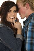 image of she-male  - a couple together he is whispering in her ear she has a confused expression - JPG