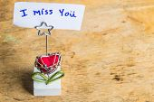 stock photo of miss you  - Message i miss you on wooden table - JPG
