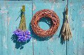 Wheat, Cornflower And Wooden Wreath On Farm Wall