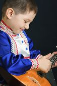 Little Boy Playing Balalaika