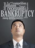 Businessman Looking Up In Word Cloud Of Bankruptcy