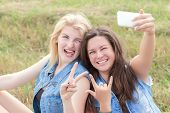 Friends rock and make selfie