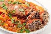 foto of meatloaf  - Homemade meatloaf baked in tomato sauce with peas and potatoes on a serving dish - JPG
