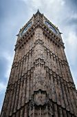 Architectural detail of Big Ben, London viewed from the foot of the building looking up showing the ornate Gothic style stonework of the facade