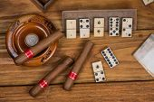 picture of cigar  - Pure cigars and domino board on table - JPG