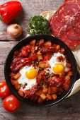 Baked Eggs With Chorizo And Vegetables Close Up Top View