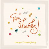 Thanksgiving greeting card with stylish text Give Thanks on ribbon decorated beige background .