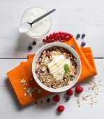 Cereal With Yogurt And Fruits On Wood