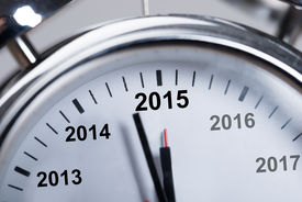 stock photo of happy new year 2013  - Closeup of happy new year 2015 in alarmclock - JPG