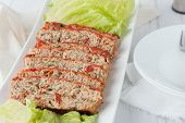 foto of turkey dinner  - a serving platter of sliced turkey meatloaf with spinach and sundried tomatoes - JPG