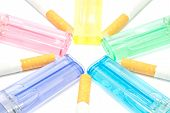 stock photo of cigarette lighter  - colorful lighters and few cigarettes on white - JPG