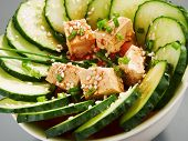 stock photo of cucumbers  - Healthy salad made of cucumber tomato tofu sesame seeds and fresh onion - JPG