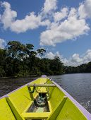 image of suriname  - Canoe in the Suriname river on a sunny and cloudy day - JPG
