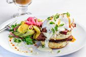 stock photo of benediction  - A breakfast plate of Eggs Benedict with Tasso