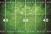 picture of football field  - Grunge American football field with white chalk drawn lines - JPG