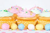 image of easter candy  - Pastel Easter cupcakes with candy and sprinkles shallow depth of field - JPG