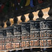 stock photo of nepali  - Buddhist prayer wheels in Kathmandu in Nepal - JPG