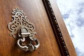 stock photo of mansion  - Close up of a door knocker of a French mansion - JPG