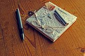 stock photo of scribes  - Old diary memories with a pen on a wooden table - JPG
