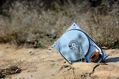 picture of outdated  - lost computer hard drive on sand in forest - JPG