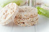 stock photo of crispy rice  - four plain rice cakes on white background - JPG