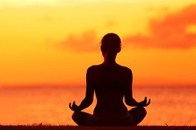 pic of orange  - Zen yoga woman doing meditation on beach  - JPG