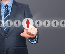 stock photo of network  - Businessman pressing button on virtual screens - JPG