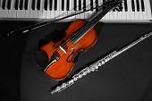 stock photo of wind instrument  - Musical instruments on dark background - JPG