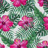stock photo of jungle flowers  - Watercolor hibiscus flower and palm leaves seamless pattern - JPG