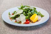 image of pine nut  - Salad with arugula cherry tomatoes pine nuts parmesan cheese - JPG