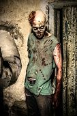 stock photo of horror  - Horrible scary zombie man on the ruins of an old house - JPG