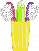 picture of toothpaste  - Green tube of toothpaste with toothbrush in a yellow cup - JPG
