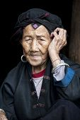 foto of woman dragon  - A beautiful 96 year old woman from the Hong Yao ethnic group living in the village of Dazhai part of the Dragon - JPG