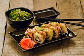 stock photo of soy sauce  - Sushi and chuka seaweed salad with soy sauce on wooden table - JPG