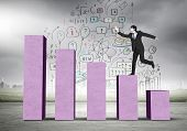 pic of step-up  - Young businessman stepping up on chart bar - JPG