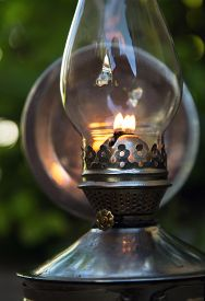 foto of kerosene lamp  - old kerosene lamp stands on the ground outdoors - JPG