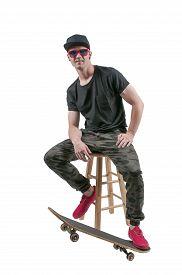 image of skateboard  - Handsome young man skateboarder with his skateboard - JPG