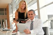 stock photo of blonde woman  - Manager and assistant working in the office - JPG