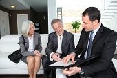 foto of old couple  - Senior couple signing financial contract for property purchase - JPG