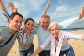 stock photo of family vacations  - Family vacation at the beach - JPG