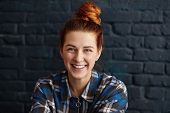 Beautiful Young Redhead Female With Hair Knot Wearing Blue Checkered Shirt Looking At Camera With Cu poster