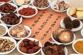 Traditional chinese herb selection used in herbal medicine in porcelain bowls with calligraphy scrip poster