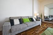 large contemporary stylish fabric sofa in a bright lounge