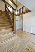 vintage wooden stairs with handcrafted rails