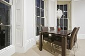 dining area with four seats in oval bay window