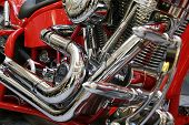 close up to the engine of a red motorbike