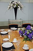 formal dining table set up with flowers